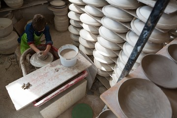 Boy making a pot