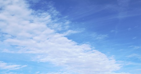 Thin, wispy ,white Cirrus clouds floating on a cold, brilliant winter sky with tints of blue