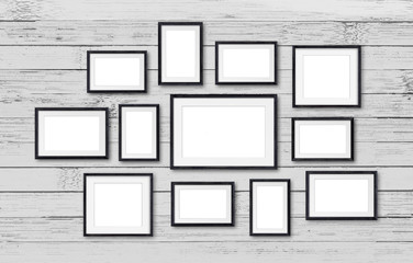 Photo frames collage, twelve set collection on wooden planks wall, interior decor mockup, gallery style. 3D illustration