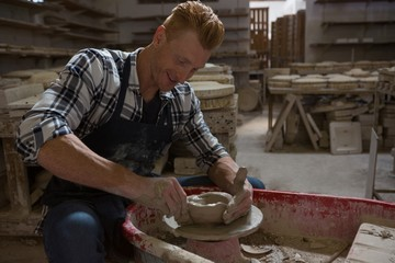 Male potter making a pot