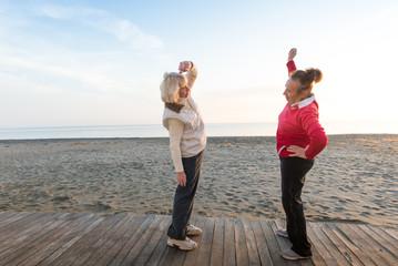 two senior women workout outdoor