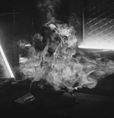 Close-up Portrait of sexy young hipster smoking (vaping) girl. Vapor concept. Vaping e-Cigarette.