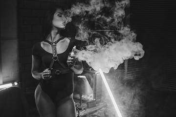 Sexy woman vaping electronic hookah. Vape concept