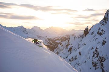 A skier does powder skiing in the Arlberg region, Austria.