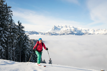 A woman does cross country skiing in fresh powder snow at Werfenweng near Salzburg.
