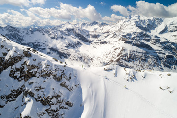 Aerial view of a group of 3 people  ski touring in the Sportgastein ski area in Austria.