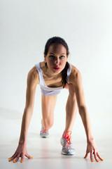 Woman in sportswear on a white background.