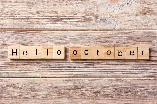 Hello October word written on wood block. Hello October text on table, concept