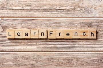 learn french word written on wood block. learn french text on table, concept