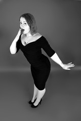 pin up girl in black wiggle dress, 1950s vintage fashion, retro style