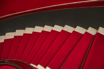Red carpet on marble stairway welcoming VIPs.