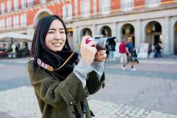 Woman tourist with camera