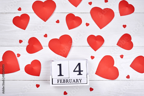 Valentines Day Background With Paper Red Hearts And Wooden Block