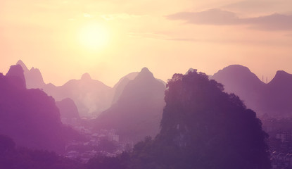 Scenic sunset over Karst mountains formations in Guilin, one of China most popular tourist destinations. Color toned picture.