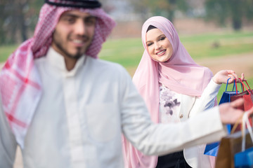 Lovely uslim couple taking a walk after shopping