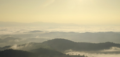 Landscape of mountain with the clouds and fog, Top view of the haze on the mountain, The foggy morning at the mountain.