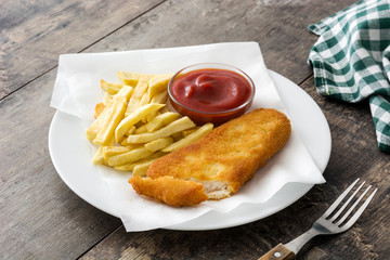 Traditional British fish and chips on wooden table. Copyspace