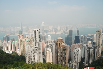 Hong Kong panorama with skyscrapers and Victoria Bay from the top of The Peak hill