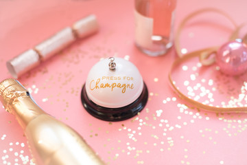 Pink and gold champagne flat lay with glitter