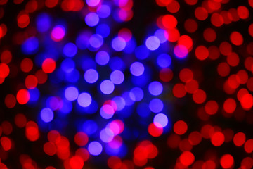 Bokeh from New Year's garlands in the form of snowflakes.