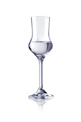 A glass of grappa on a white background