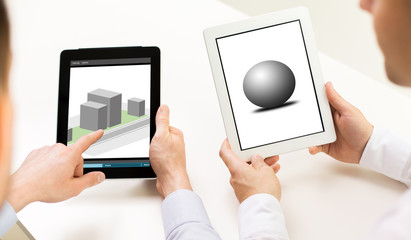 designers with 3d models on tablet pc screens