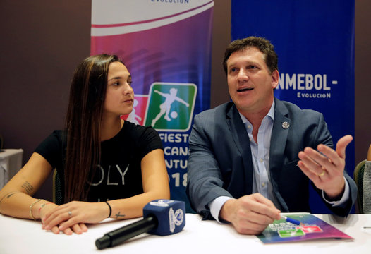Alejandro Dominguez, president of CONMEBOL, makes declarations to the media during a press conference alongside Venezuela's soccer player Deyna Castellanos at CONMEBOL's headquarters in Luque