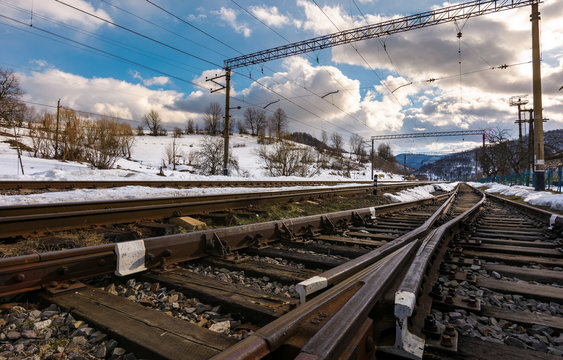 old railroad in winter mountain on a cloudy day. transportation background
