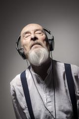 elderly male portrait with headphones