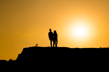 twp lovers silhouette at sunset
