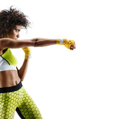 Boxer woman in yellow bandages making direct hit. Photo of sporty woman during boxing on white background. Dynamic movement. Side view