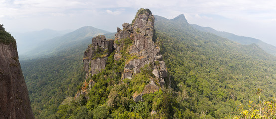 Panoramic landscape of nature with a mountain and a tropical forest in Hot Springs National Forest Park in Hainan Qixianling