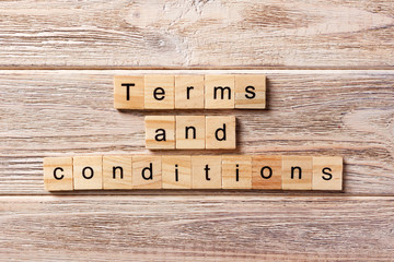 Terms and Conditions word written on wood block. Terms and Conditions text on table, concept