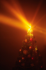 Christmas tree shiny star lights, orange background with mist