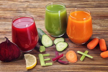 Word DETOX made of ingredients and glasses with various fresh juices on table
