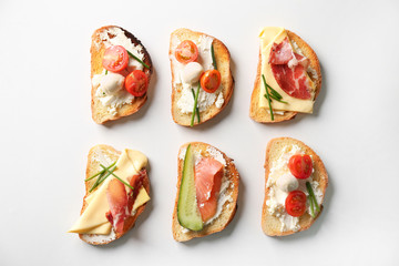 Delicious sandwiches on white background, top view