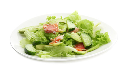 Plate with delicious vegetable salad on white background