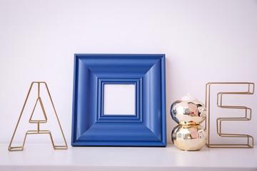 Mockup of blank frame with decor on light background