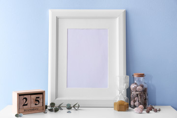 Mockup of blank frame with decor on color background