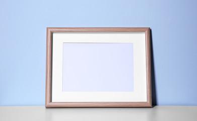 Mockup of blank frame on color background