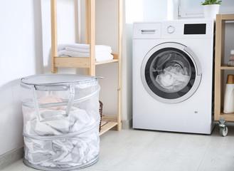 Laundry basket and washing machine indoors