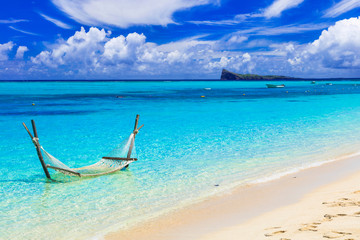 Fototapete - Relaxing tropical holidays with hammock in the turquoise sea.