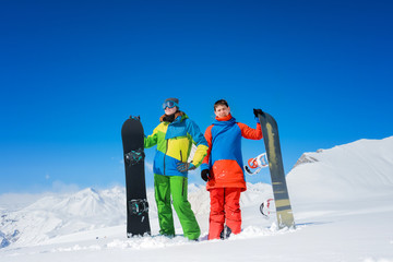 pair of snowboarders a man and a woman