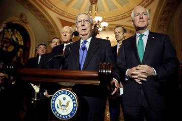 Senate Majority Leader McConnell, accompanied by Sen. Gardner (R-CO), Sen. Barrasso (R-WY), Sen. Hatch (R-UT), Sen. Thune (R-SD), and Sen. Cornyn (R-TX), speaks about the Tax Cuts and Jobs Acts at news conference in Washington