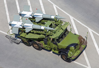 Military vehicle with rackets