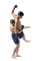 Attractive young men wrestling on white background