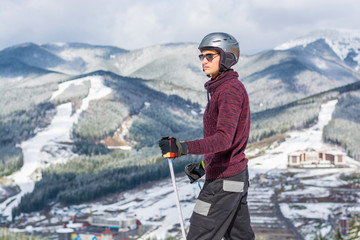 Skier in glasses and a helmet riding a mountain