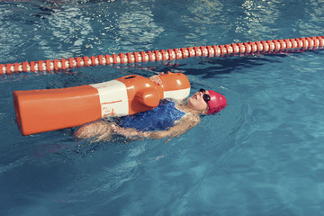 One Girl with Training Dummy in a Pool