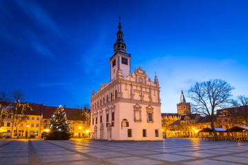 Old town square with historical town hall in Chelmno at dusk, Poland