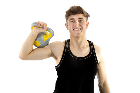 18 year old teenage boy exercising with weights